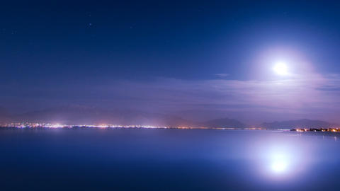 Time lapse moon rising through night sky Live Action