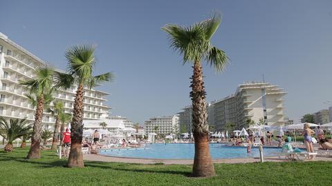 People sunbathe near the pool Archivo