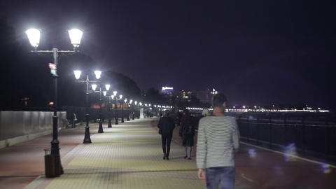 People walk in the evening along the promenade in Sochi 2 Footage