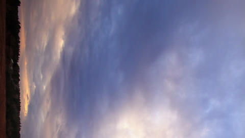 Vertical video. The weather is changing at sunset. Time Lapse Footage