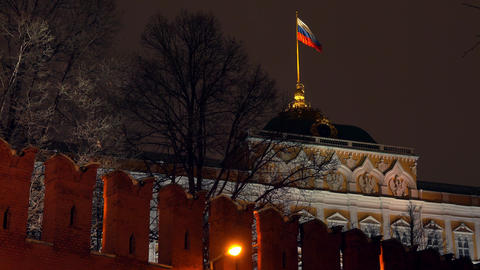 Waving flag of Russia above the Moscow Kremlin at night Footage