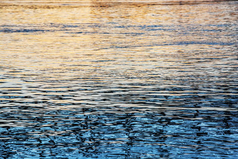 Water surface of Danube river in sunset フォト