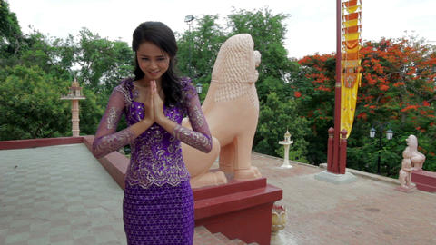 Asian Girl saluting in temple Footage