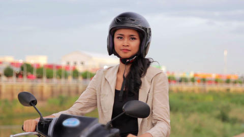 gorgeous asian girl with motorcycle Stock Video Footage