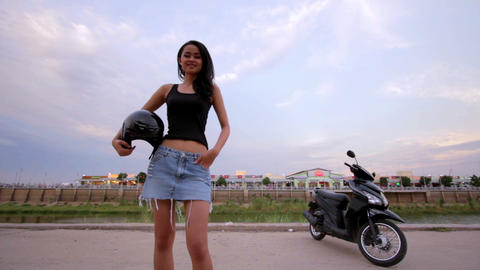 gorgeous asian girl with motorcycle Footage