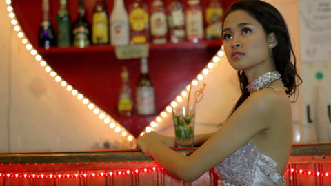 gorgeous woman watching TV at bar Stock Video Footage