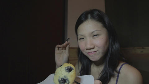 Young asian woman and cake Stock Video Footage
