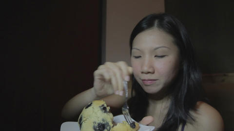Young asian woman and cake Live Action