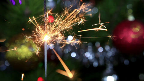 Christmas tree, mirror ball and lit sparkler Stock Video Footage