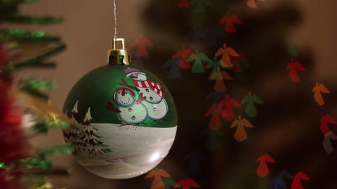 Christmas-tree decorations on angel-shaped background Stock Video Footage