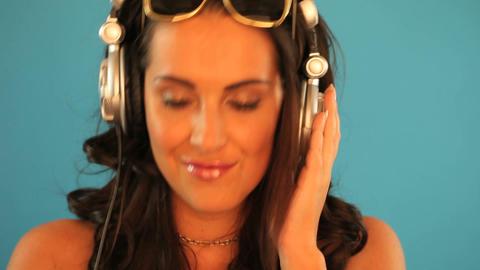 Brunette disc jockey listening to music Stock Video Footage