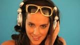 Brunette disc jockey listening to music Footage