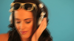 Brunette disc jockey listening to music Stock Video Footage
