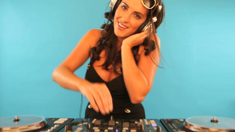 Attractive female DJ mixing music Stock Video Footage