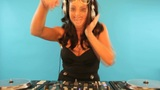 Attractive female DJ mixing music Footage