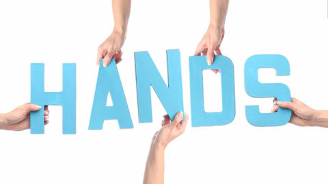 Female hands holding up HANDS letters Stock Video Footage