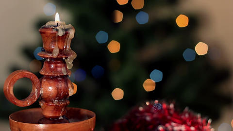 Christmas candle on background of the color lights Stock Video Footage