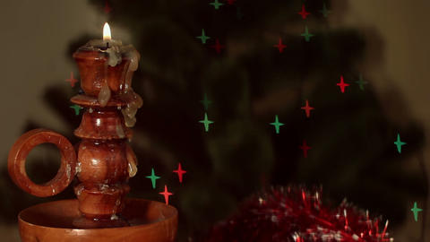 Christmas candle on starshaped background Stock Video Footage
