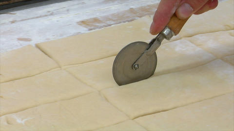 german bakery cuts pieces of dough 10762 Stock Video Footage