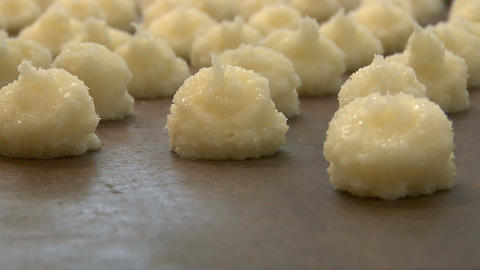 german bakery squirt coconut macaroons onto plate close... Stock Video Footage