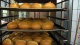 german bakery roll bun out of rotary oven 10768 Footage