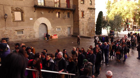 Visitors queue up in front of Barcelona Cathedral, stand along Seu square Footage
