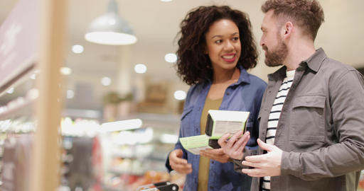 Couple choosing a ready meal in grocery store Footage