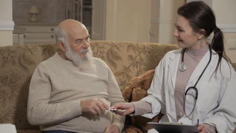 Health visitor prescribes pills to old patient Footage