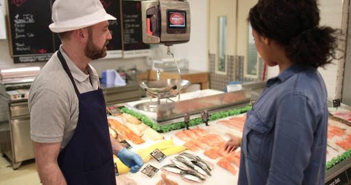 Customer asking fishmonger for advice Footage