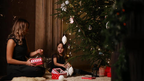 Mom and her little daughter choose rozhdetsvenskie toys for decorating the tree Footage