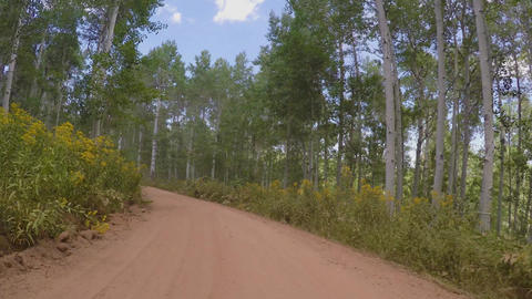 Driving along a dirt road with lots of dust B Footage