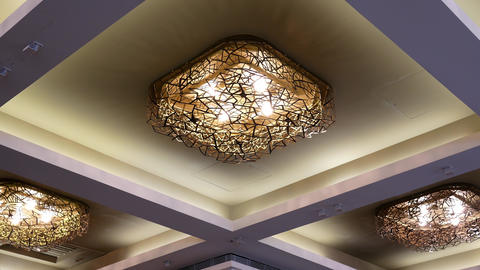 Low angle shot of elegant lighting on the ceiling in a luxury restaurant with 4k Footage