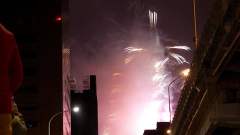 Motion of people standing on street to watch fireworks near Taipei 101 Tower for Footage