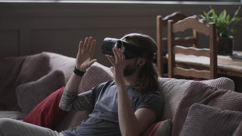 Young adult male using VR headset Live Action