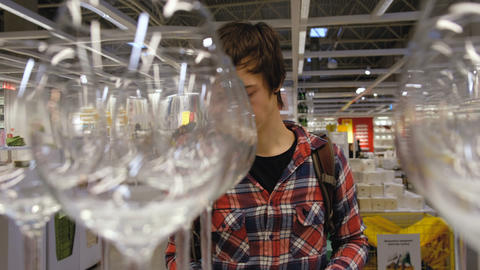 Caucasian man chooses a product in the supermarket, looking glasses, 4K Live Action