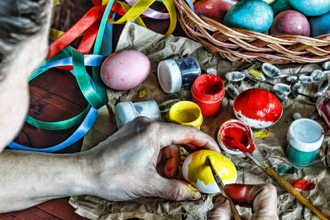 Easter. A woman is decorating Easter eggs at home Photo