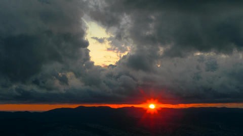 Unusual Sunset Over Black Clouds 영상물
