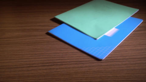 Two Notebooks Falling On Table Archivo