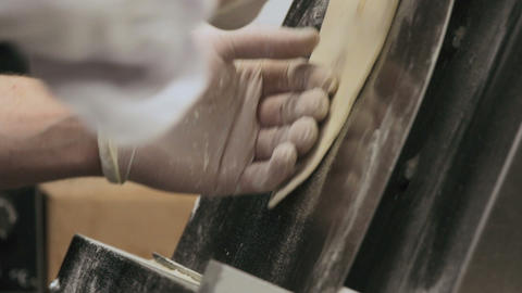 Chef preparing a dough for pizza in stretching machine Footage
