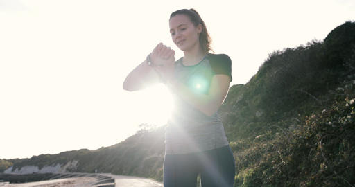Female jogger checking smart watch Footage