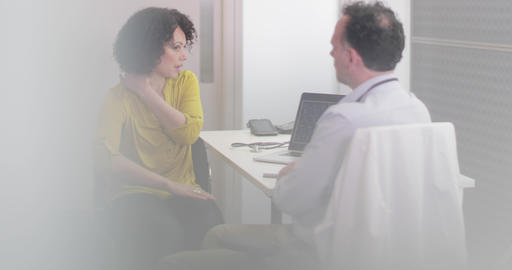 Male Medical Doctor listening to patient symptoms Image