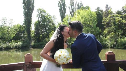 Bride and Groom Wedding Day Kiss Medium Shot Live Action