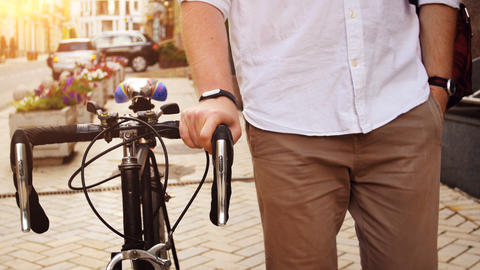 4k footage of young hipster man walking on street with vintage bicycle Footage