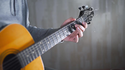Guitarist plays on the acoustic western guitar with steel strings spanish random Footage