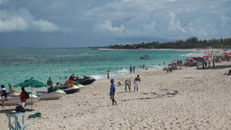 Bahamas Nassau Paradise Island Cabbage Beach with jet skies at the shore Filmmaterial