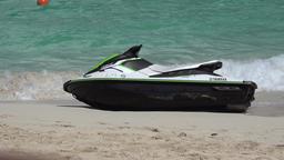 Bahamas Nassau Paradise Island Cabbage Beach Jet Ski tilts in waves Image