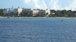 Bahamas Nassau beach resort hotels between trees seen from cruise ship ビデオ