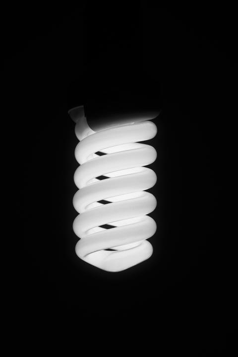 Fluorescent energy saving lamp on a black background Photo