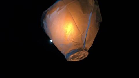 Single Paper balloon lantern lifting at night Footage