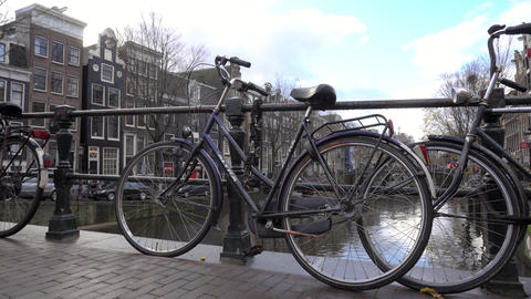 Dutch Bike Chained to a Bridge Image